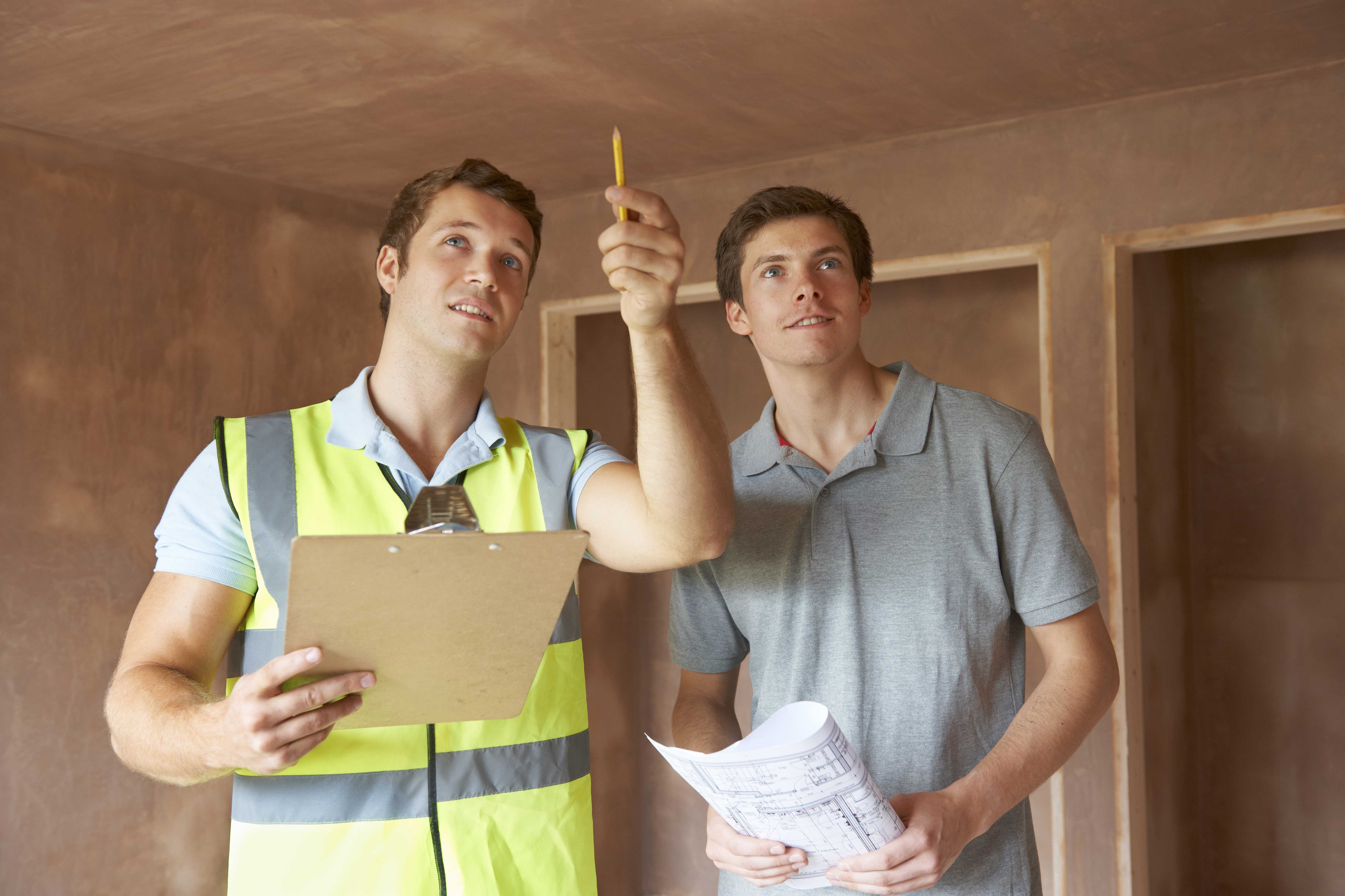 inspector with home owner